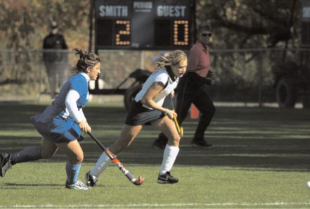 Front of Smith College Athletic Postcard Smith vs. Wellesley  Grace Wittenberg '10 with the Ball. 2006 Smith Field Hockey Team.